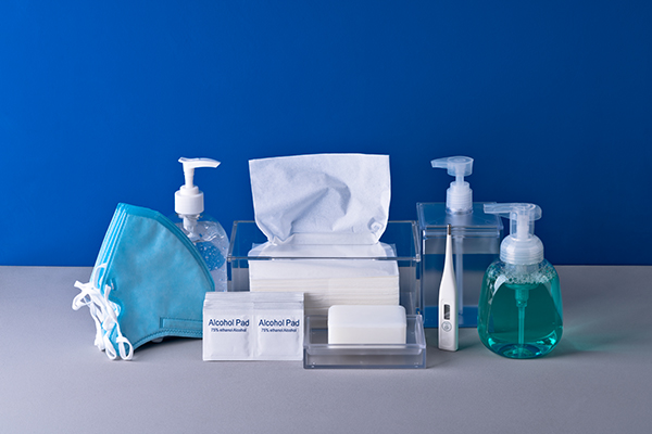 Anti-epidemic Supplies Collection on Blue Colored Background.