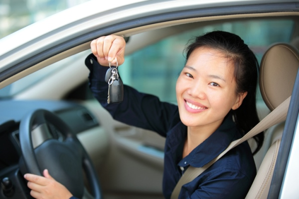 Young driver holding keys