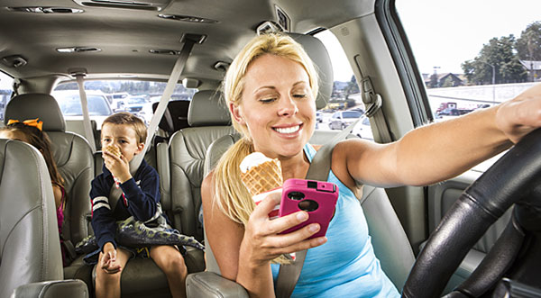 Mom driving distracted: texting and eating while driving