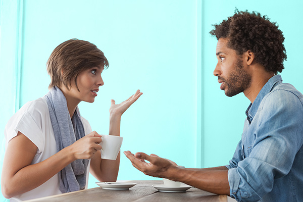 Couple arguing over coffee