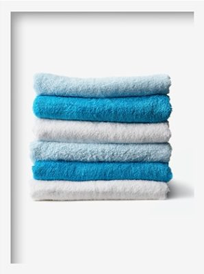 bathroom towels folded in a pile