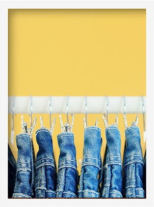 jeans hanging in a closet