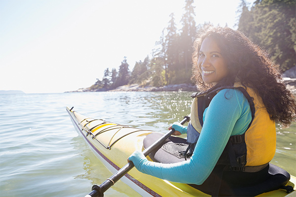young woman kayaking