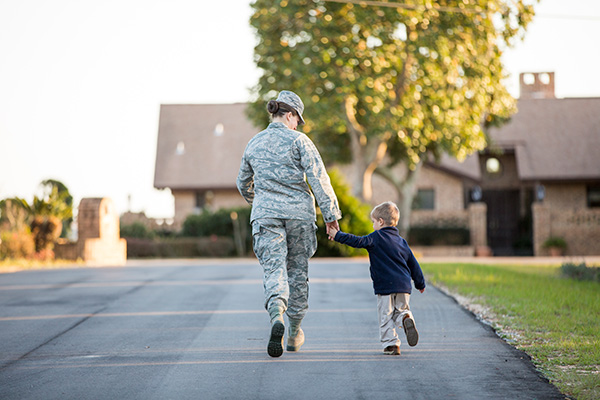 Military mother and son walking