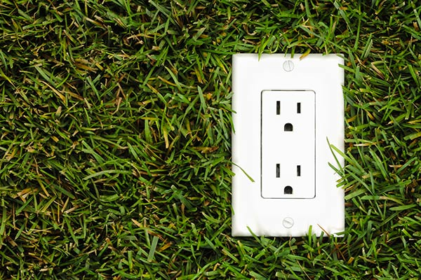electrical plug on grass lawn