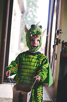 kid in dragon costume
