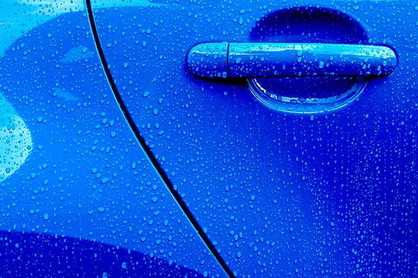 blue car with raindrops