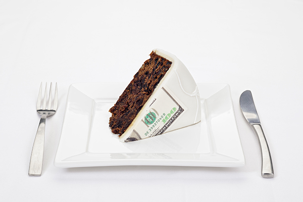 cake slice with $100 bill lasered in icing