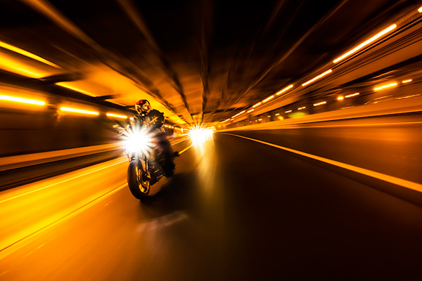 motorcycle riding through tunnel