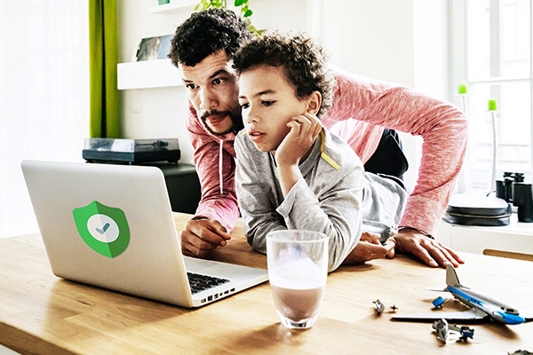 father and son on computer