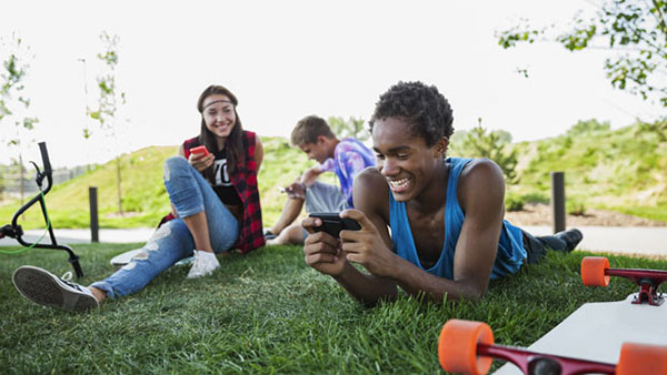 Teens enjoying their high-tech gadgets together