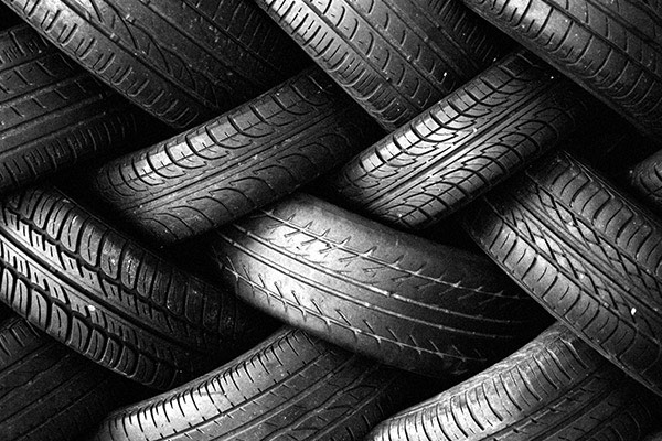 Tires stacked in zig zag pattern