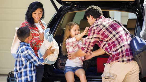 Family packing car for Spring Break road trip