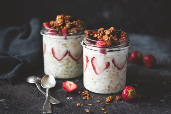 Overnight oats with strawberries and granola in jar. Healthy breakfast, dessert or low fat snack