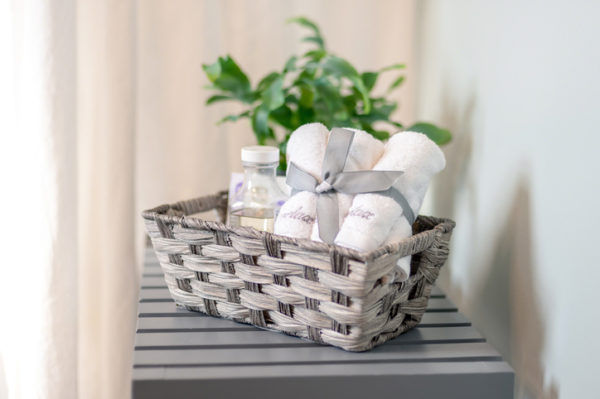 Closeup of basket of bath products beside the bathtub - home spa