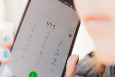 Smartphone screen with the emergency number 911 dialed – Person calling the support service phone line asking for help