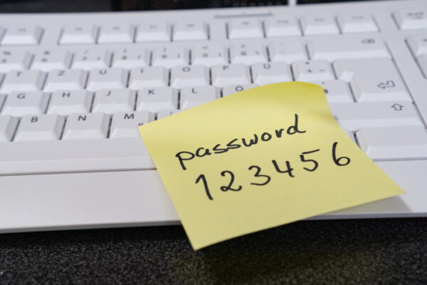 Note with the word password on a computer keyboard