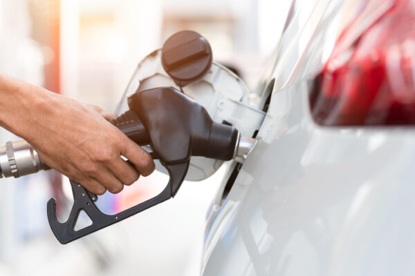 Hand refilling the car with fuel, close-up, Pumping equipment gas at gas station.