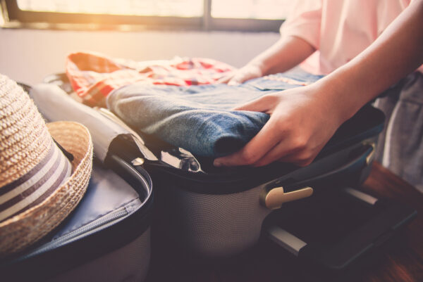 Tourists are packing luggage for travel.