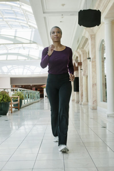 Black woman exercising in shopping mall