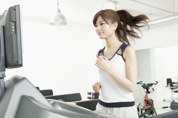Woman runs on treadmill
