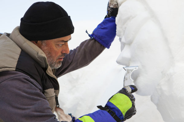 "Emiliano Lorenzo Vicente, the foreman of the Spanish team, is working on final details of his snow sculpture. The title of the opera is ""A real italian icon"" and will classified at the first place at the International Snow Festival of San Candido. This important event happens every year in mid-January in San Candido and San Vigilio, in the north of Italy."