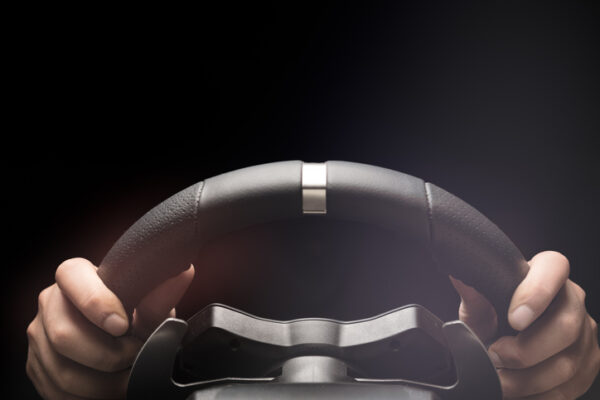Hands on steering wheel of a car