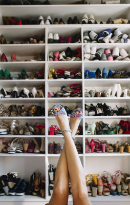 Woman's legs and Woman's shoes in the rack