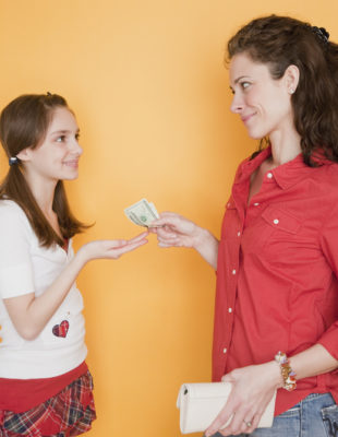 Mother giving daughter (10-11 years) pocket money