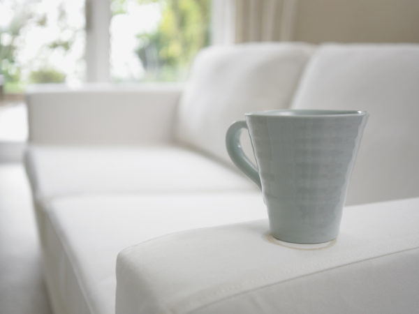 Close up of coffee cup on sofa