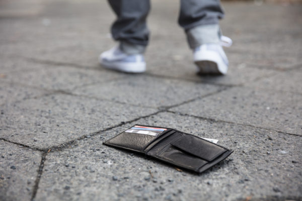 Man Walking After Losing His Wallet On Street