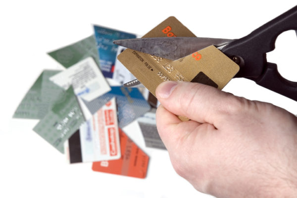 hand cutting credit cards