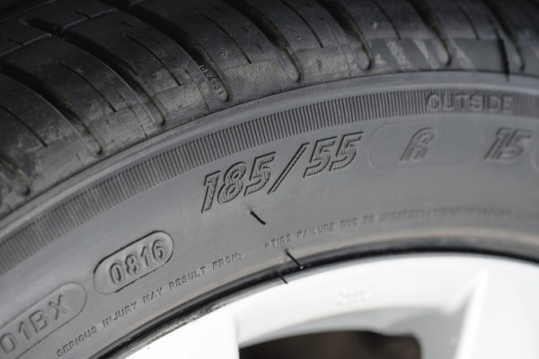 closeup details of car tire, sidewall information