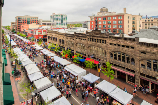 Boise, ID, USA - May 5, 2018: Bird's eye view of stalls and visitors along the street in the downtown area during Boise Farmers Market weekend in the late spring