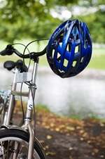 bicycle with helmet hanging from handlebars