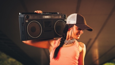 Young woman holding a boom box
