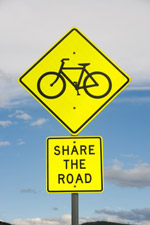 Bicycles share the road sign
