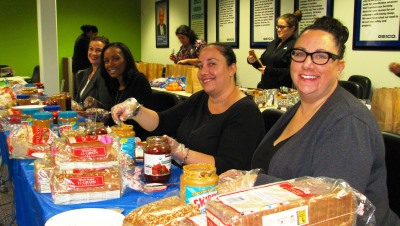 GEICO associates making sandwiches for the homeless