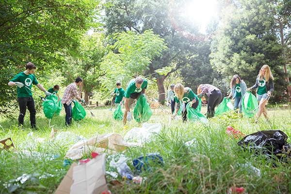 group of volunteers picking up trash