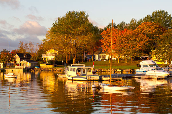 Boats on water with fall foliage