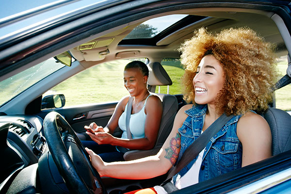 Young women driving in car
