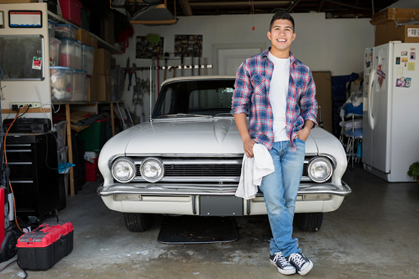 young man polishing vintage car