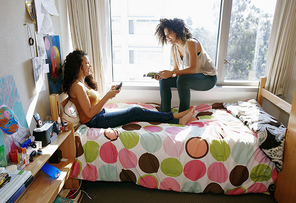 female students in dorm room