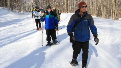 Group snowshoeing along trail Canaan Valley