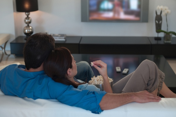 couple watching a movie at home