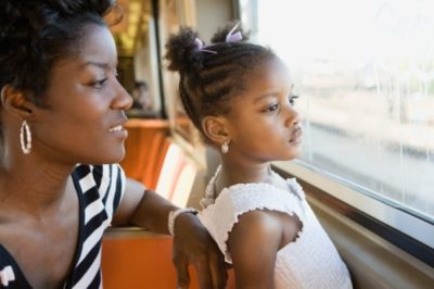 mother and daughter on city bus