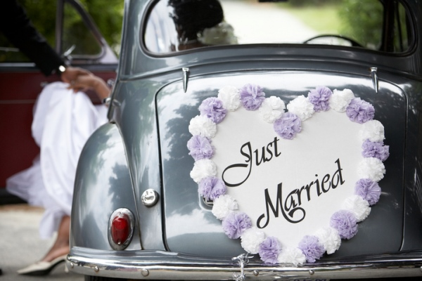 Just married sign on back of vintage car