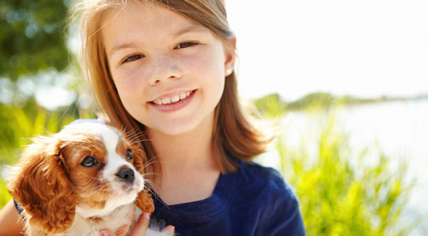 A young girl and her puppy