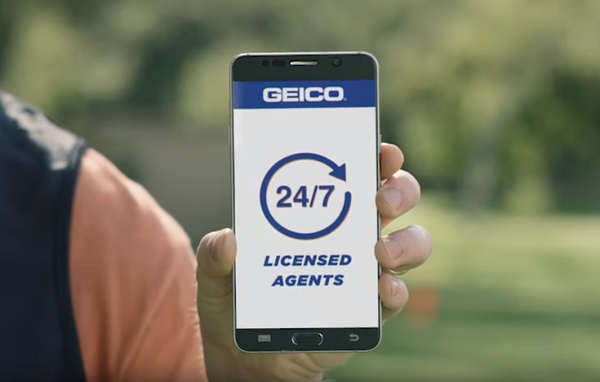 GEICO 24/7 Licensed Agents on mobile phone
