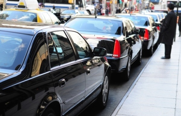 black limousines in city traffic